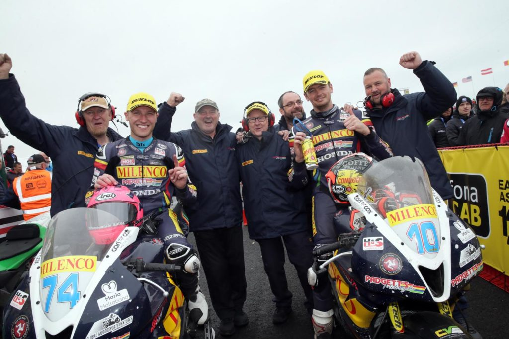 PACEMAKER BELFAST  18/05/2019 Davey Todd (74) celebrates victory during todays The Junction Supersport race at the North West 200. Team mate Conor Cummins 10 in third both riders celebrate in pit lane with the team Photo Stephen Davison/Pacemaker Press